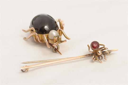 Lot 10 - A LARGE CABOCHON GARNET BEETLE brooch, circa 1870. Pearl thorax and demantoid garnet eyes. Length