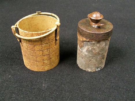 A German Second War stick grenade shrapnel sleeve, sand