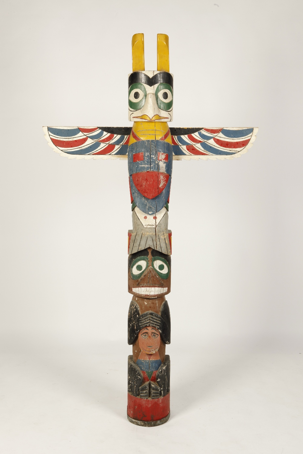 Lot 612 - A NORTH WEST PACIFIC TOTEM POLE carved with a beaver, a bear and a whale surmounted by an eagle with