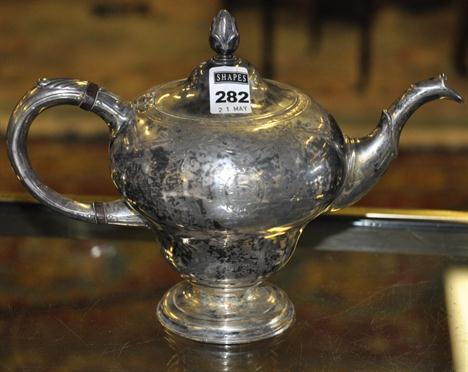 c96e0e10033 A George III Scottish silver teapot