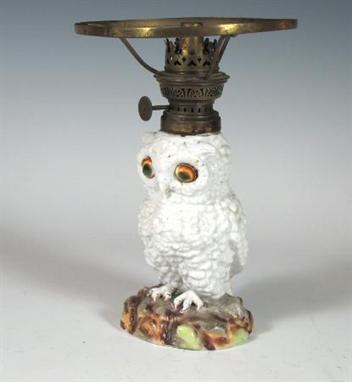 A Victorian white glazed porcelain owl oil lamp with operculum ...