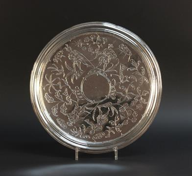 Lot 350 - A James II silver large chinoiserie footed salver, the circular top flat-chased with a continuous