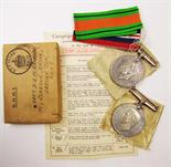 Lot 69 - A Defence Medal and a 1939-45 War Medal, in box to Captain D.G.M. Griffiths, with slip.