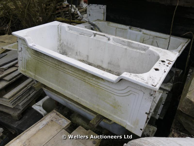 art deco cast iron bath with decorative cast iron panel