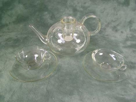 *A Schott & Gen, Jena glass tea service, designed by Willheim Wagenfeld, circa 1930s, consisting of large  teapot, 13 cups an