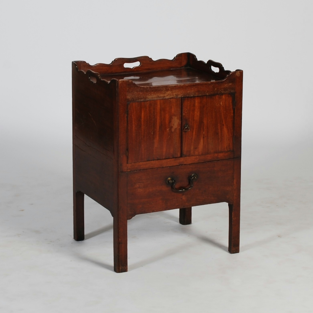 A George Iii Mahogany Tray Top Commode The Rectangular Top With Pierced Three Quarter Gallery A