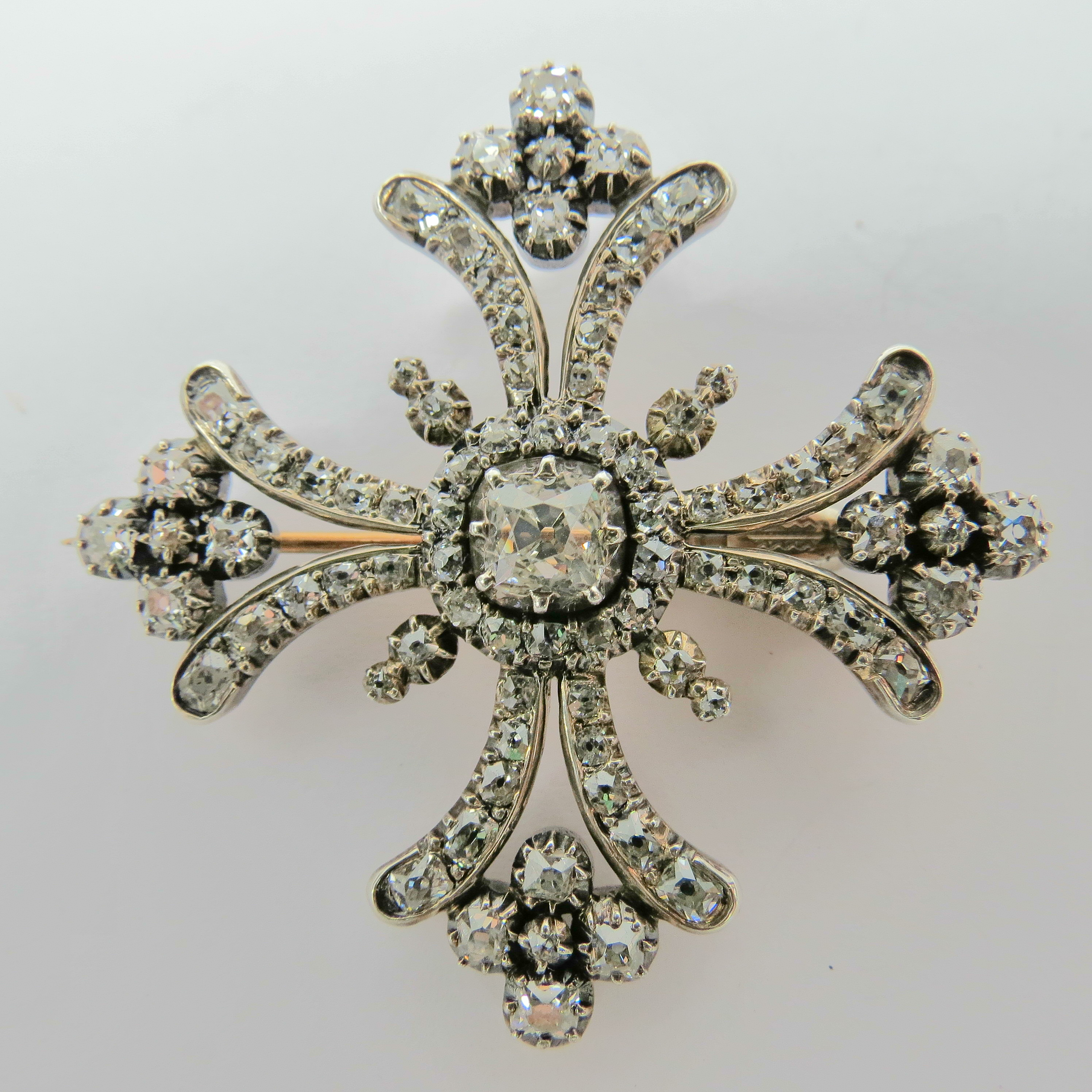 Lot 526 - A diamond set stylised Huguenot cross with central cushion shaped hobnail diamond, weight approx 0.