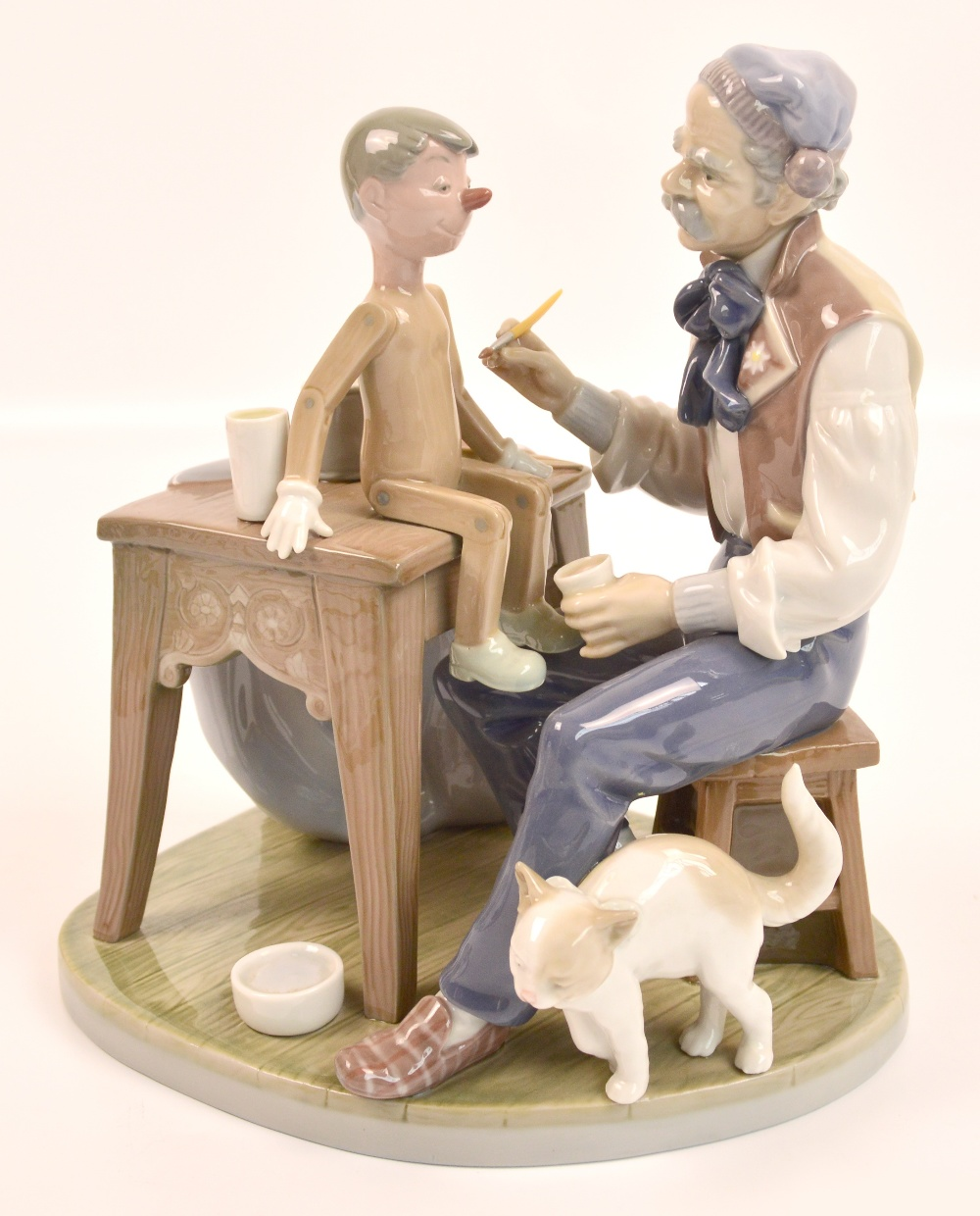A Lladro Figure Group Quot Giuseppe And Pinocchio Quot Height 23