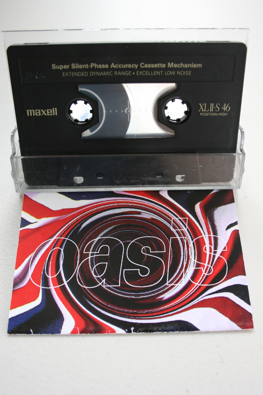 "Lot 293 - OASIS DEMO - extremely rare Oasis ""Live Demonstration"" cassette demo with Union Jack swirl design"