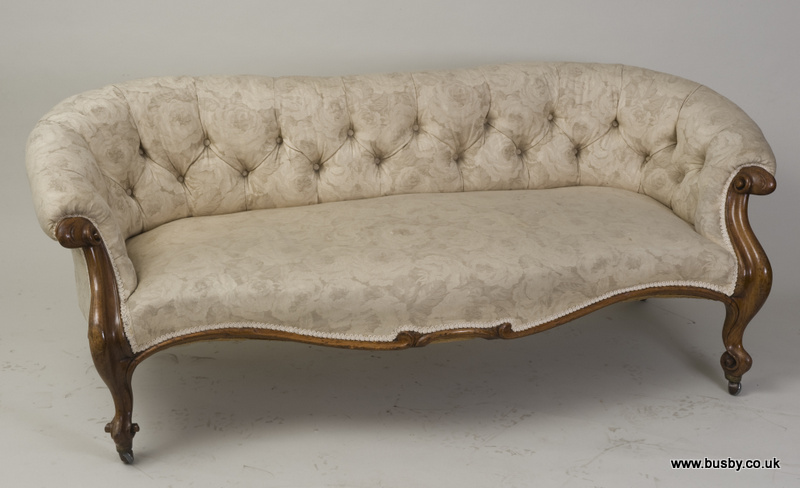 A 19th Century French Style Walnut Sofa The Serpentine Scrolling Back And Overstuffed Seat Are S